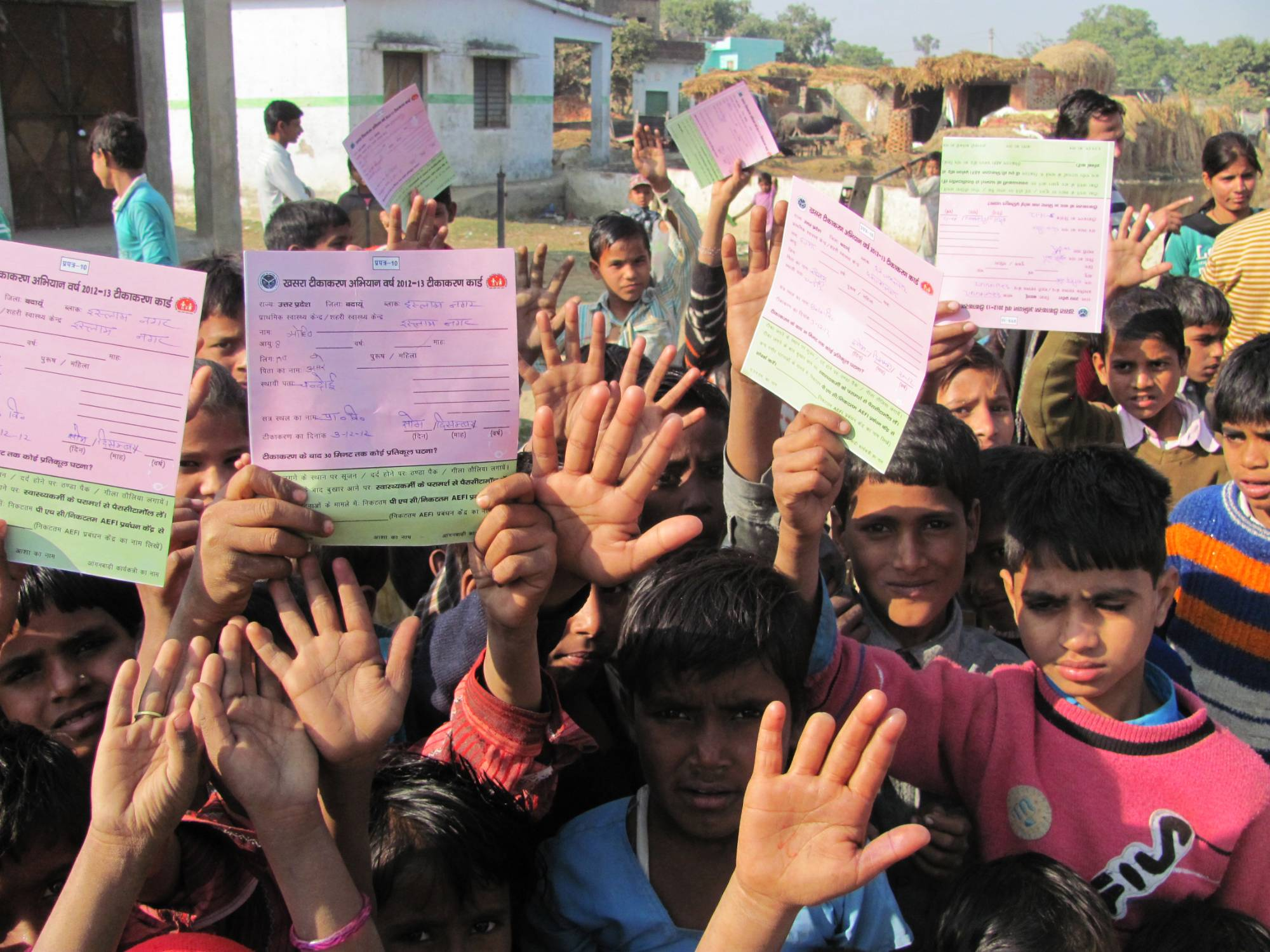 Image of children in India with vaccination cards