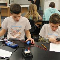 students working with circuits
