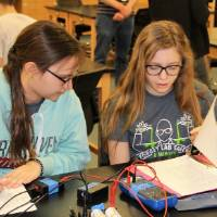 two students working on circuits