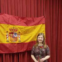 Megan Kruskie posing in front of Spanish flag