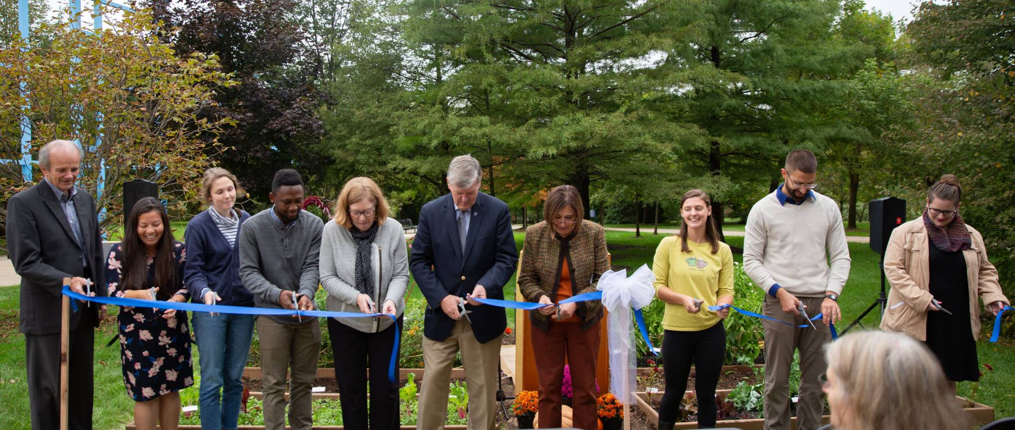 ribbon cutting at the demo garden
