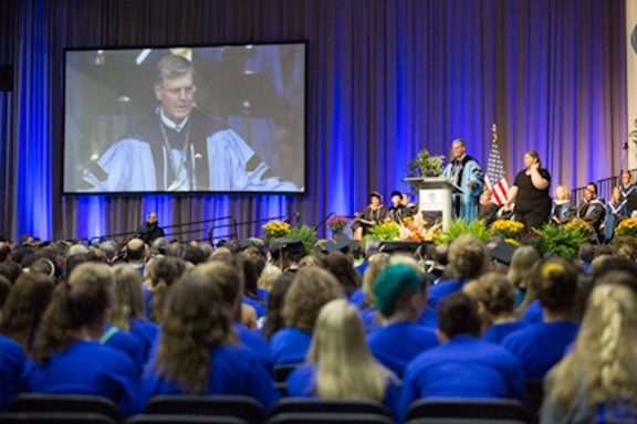 President Thomas J. Haas addresses the audience at Convocation in the Fieldhouse on August 22.