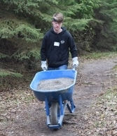Student with wheel barrow