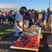 football players lined up to get food