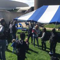 GVSU volleyball alumni, friends, and family outside at a tailgate