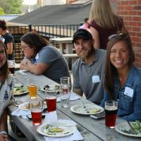 Members of the Young Alumni Council pose at Founders Brewing Co.