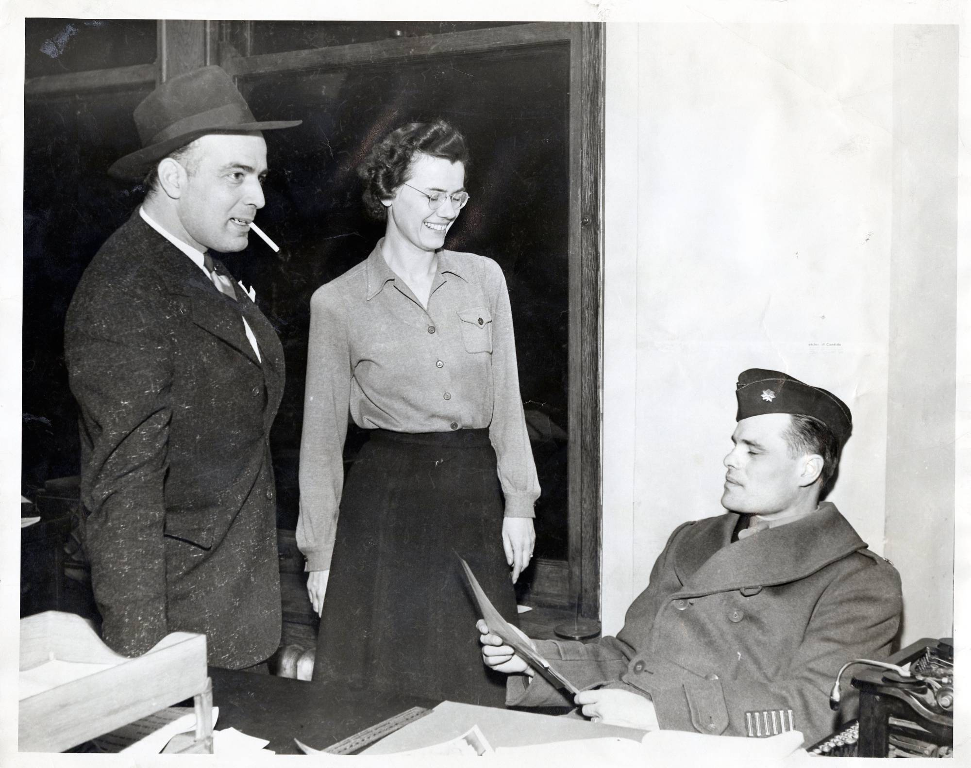 Ralph Hauenstein working with a female and a male military personal