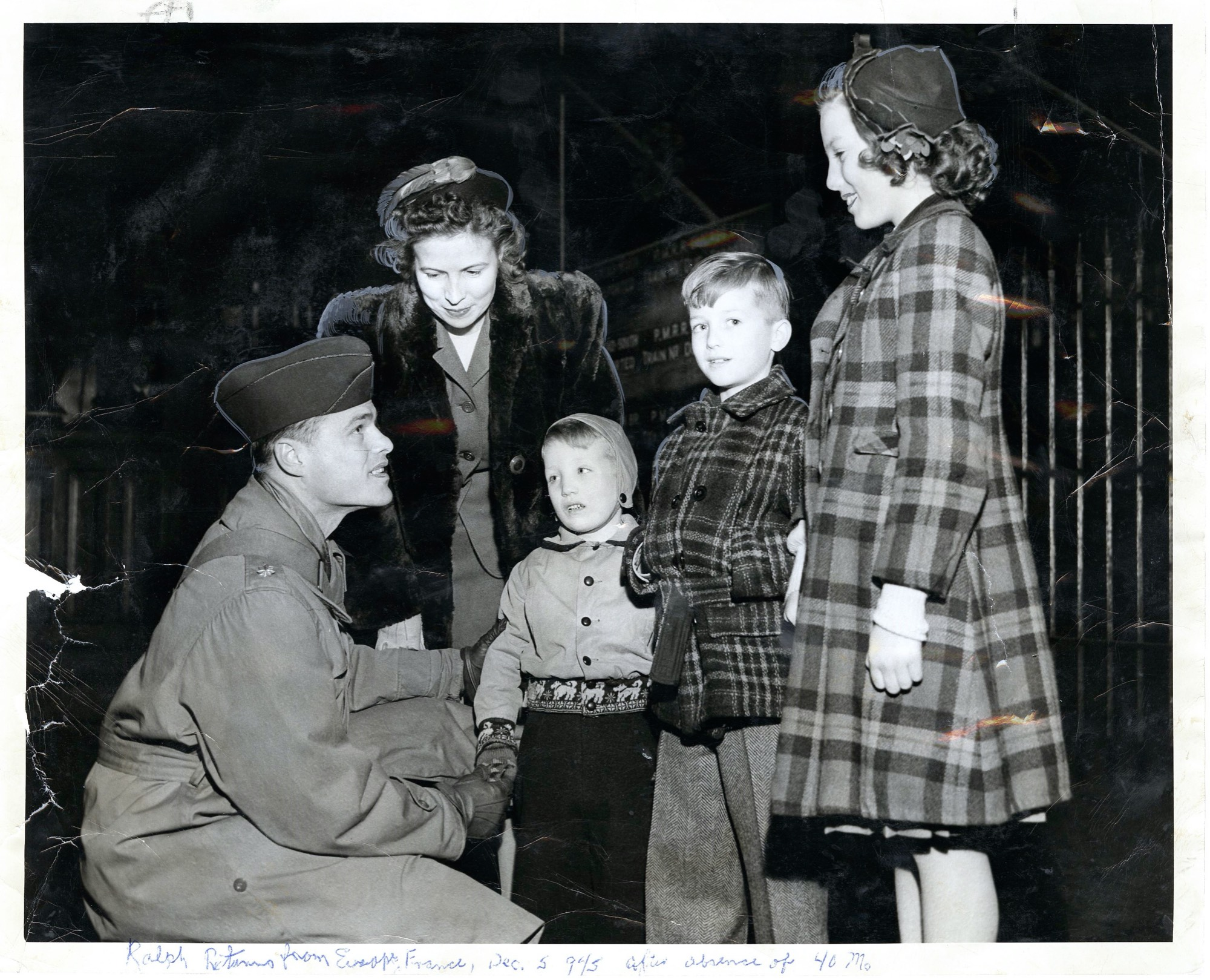 Ralph greeting his wife and children