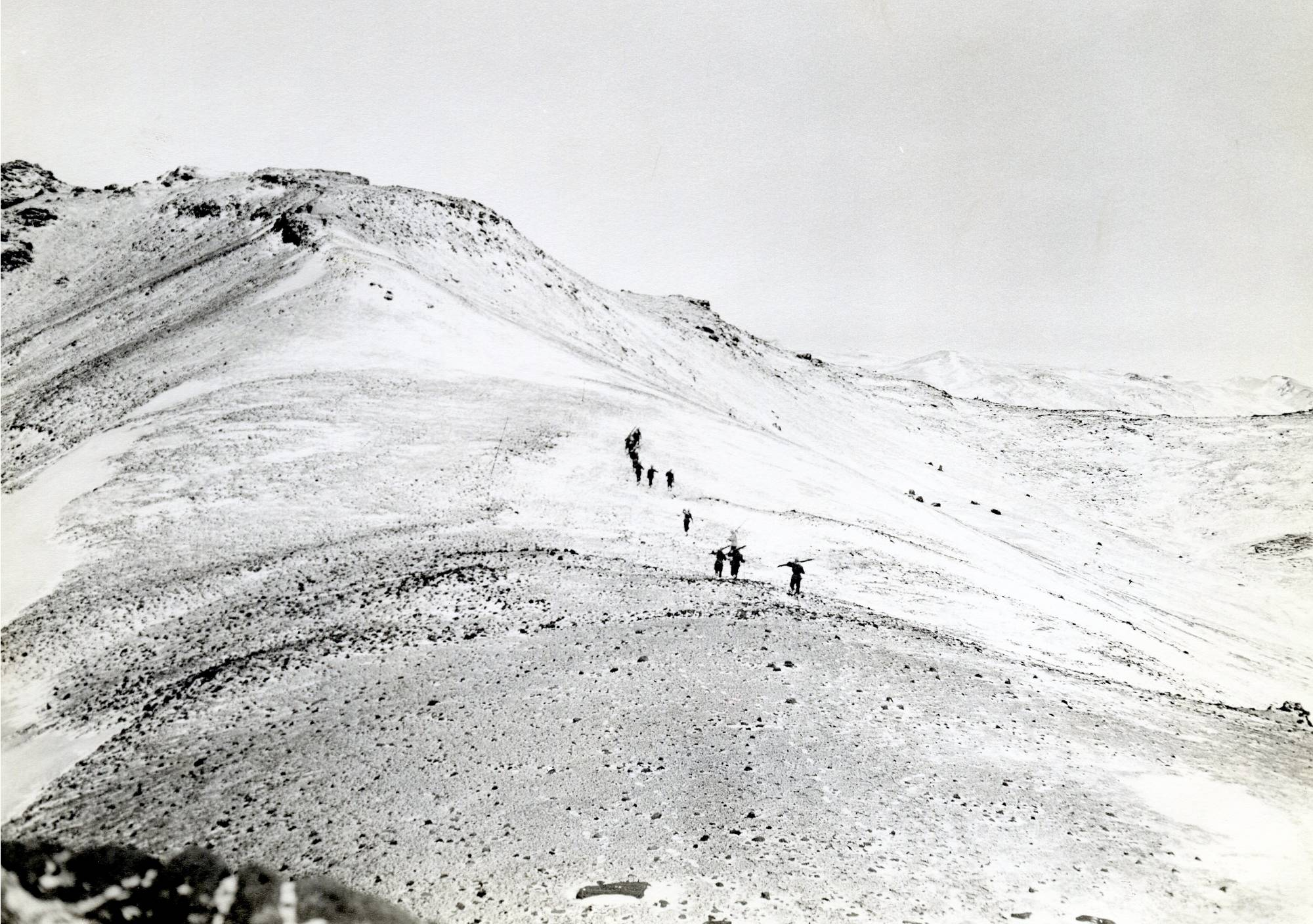 Iceland Mountains with troops martching across