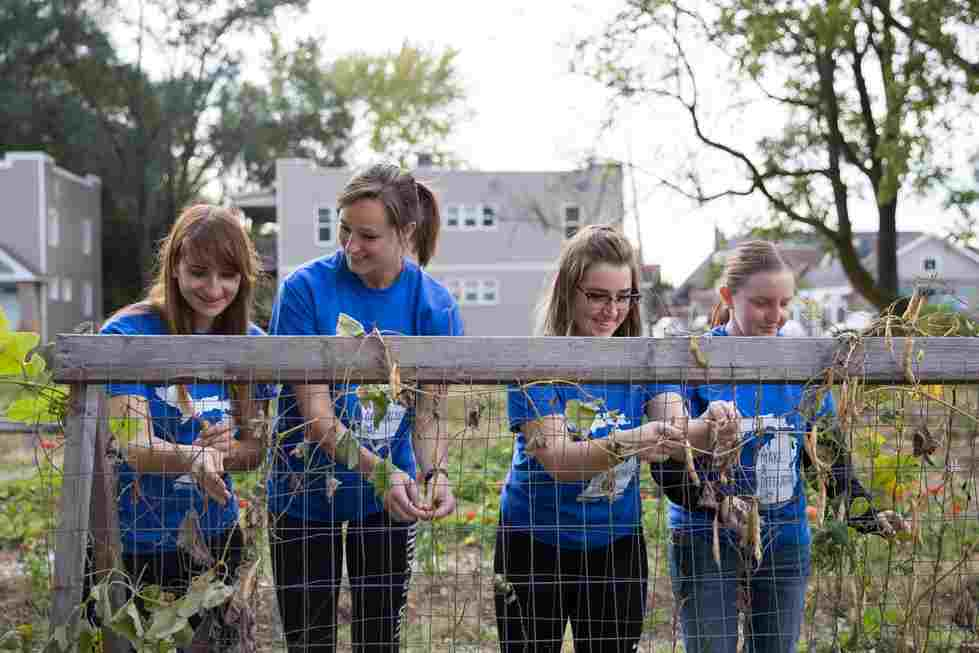 Four women tend to a local garden for Make a Difference Day