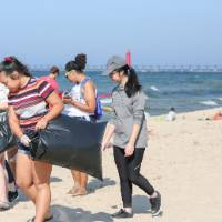 group of students pick up trash
