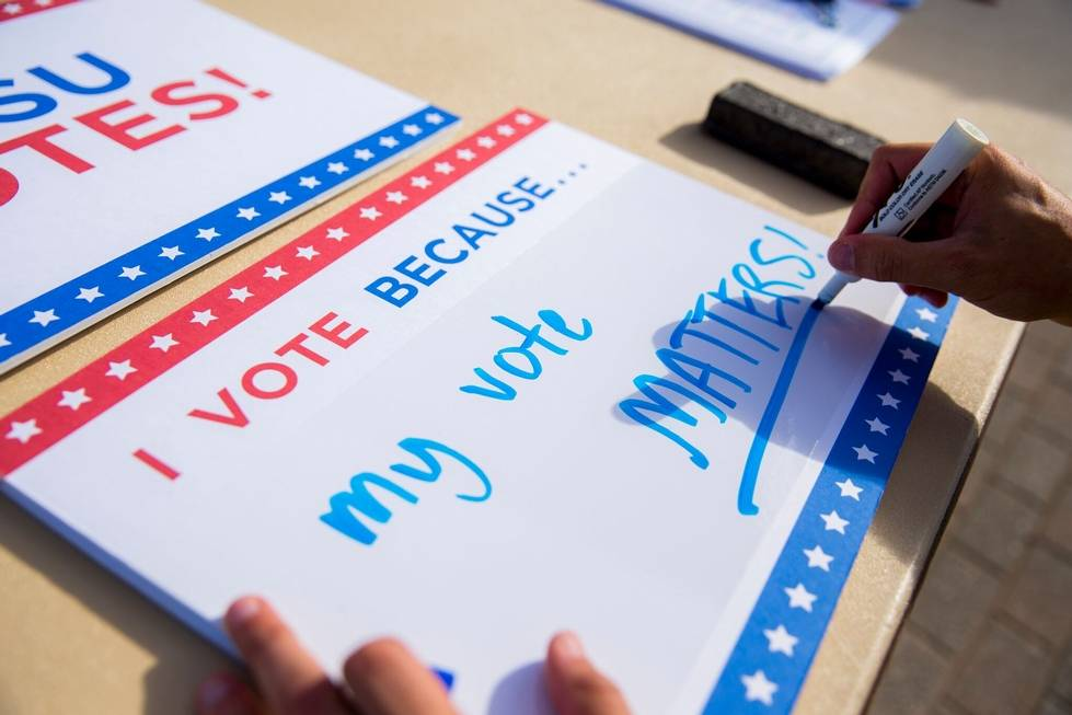 """I vote because my vote matters"" whiteboard sign"
