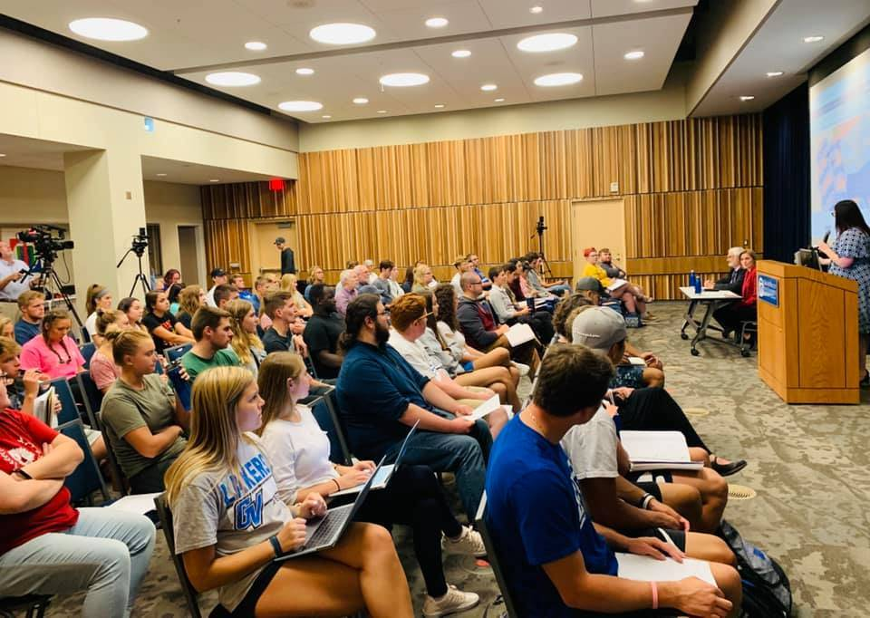 A full room of students listen in on a panel discussion about PFAS in Michigan.