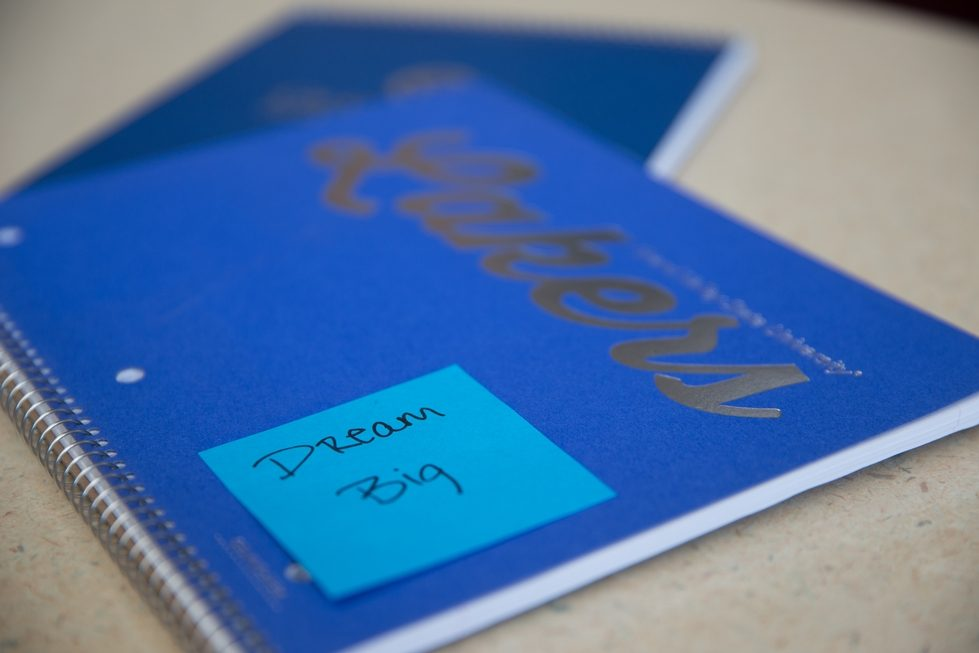 "Notebook with sticky note titled ""Dream Big"""