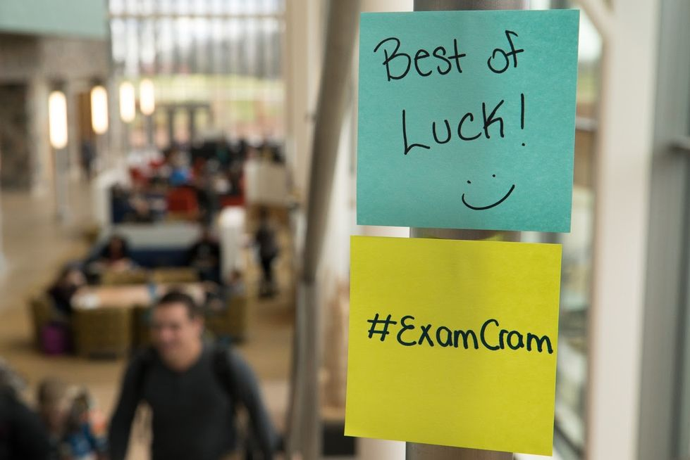 "Post it notes reading ""Best of Luck!"" and ""#examcram"""