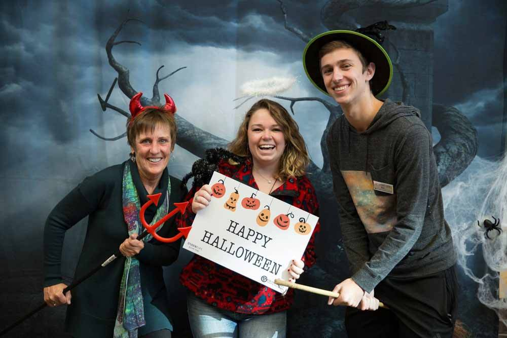 3 Student life employees dressed in Halloween costumes