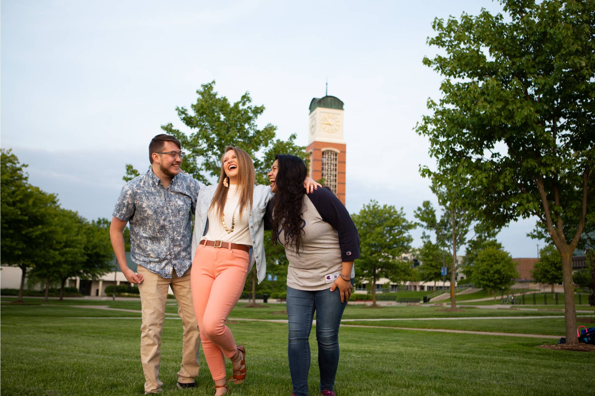 A group of students laughing by the Cook-Carillon tower.