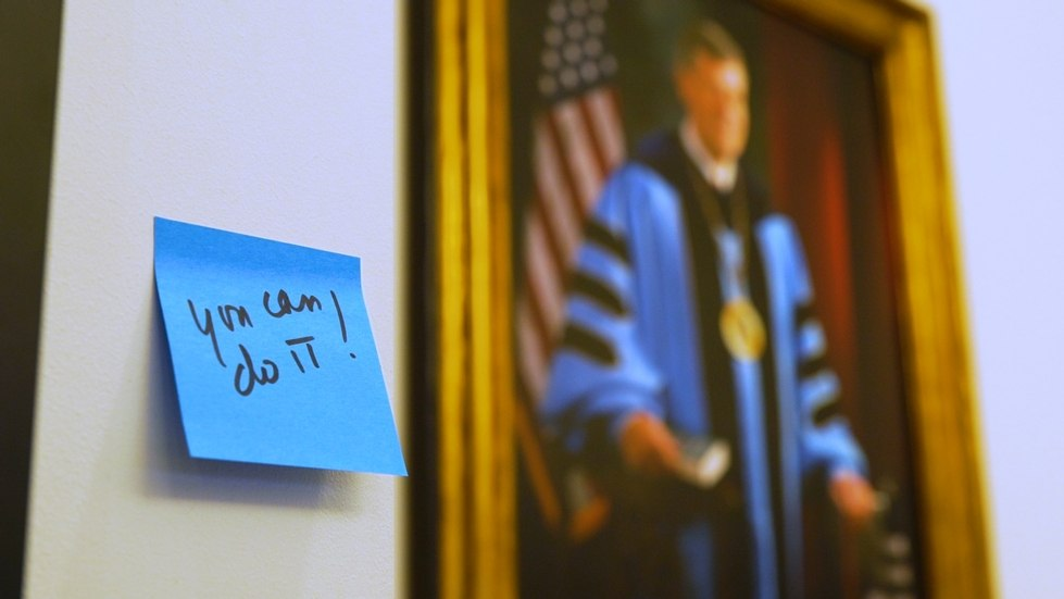 "Sticky note reading ""You can do it!"" next to a portrait of T. Haas"