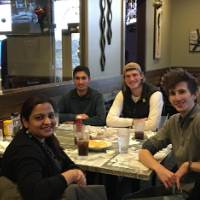 Lab members form 2018 at lunch at Main Street Pub