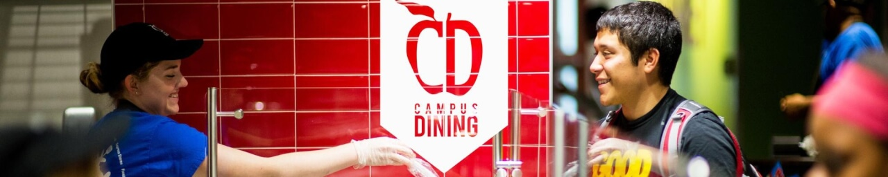 Student receiving a meal at a Campus Dining location