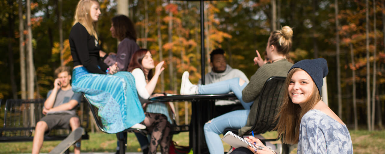 Students relaxing outside of Holton Hooker Learning and Living Center on the Allendale Campus.