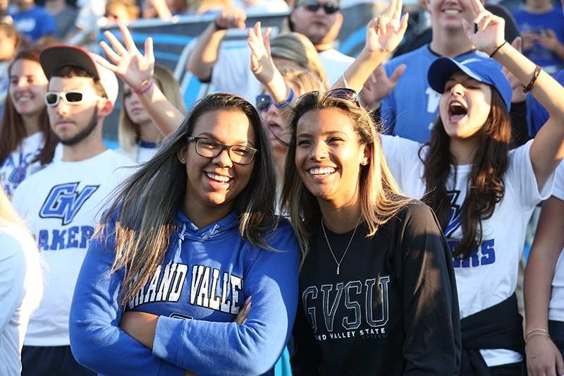 Students at a GVSU Laker football game.