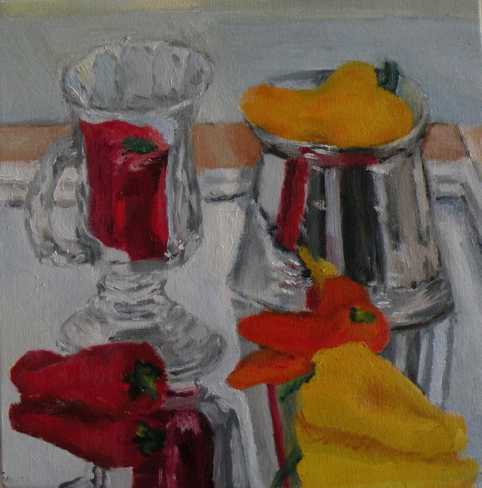 Several multicolored peppers and a glass mug on a mirror