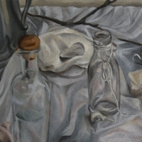 Two empty jugs on a white clothe