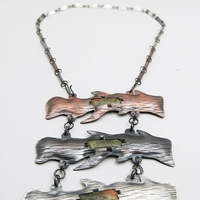 3 piece necklace with copper, a black metal, and a white metal