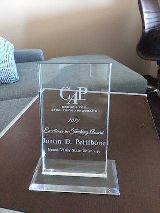 CAP Award given to Justin Pettibone in 2017.