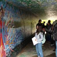 REL 340 students observing murals thinking about pop culture and religion