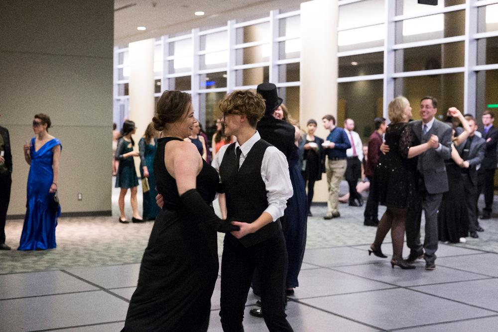 Two students swing dancing at Presidents' Ball