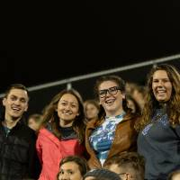 4 students taking part in the GVSU homecoming football game