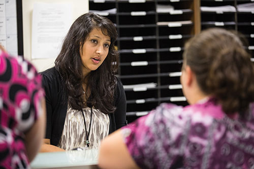 Akshita Patel, a senior majoring in legal studies, listens to a client at The Legal Assistance Center, where Patel is a volunteer.
