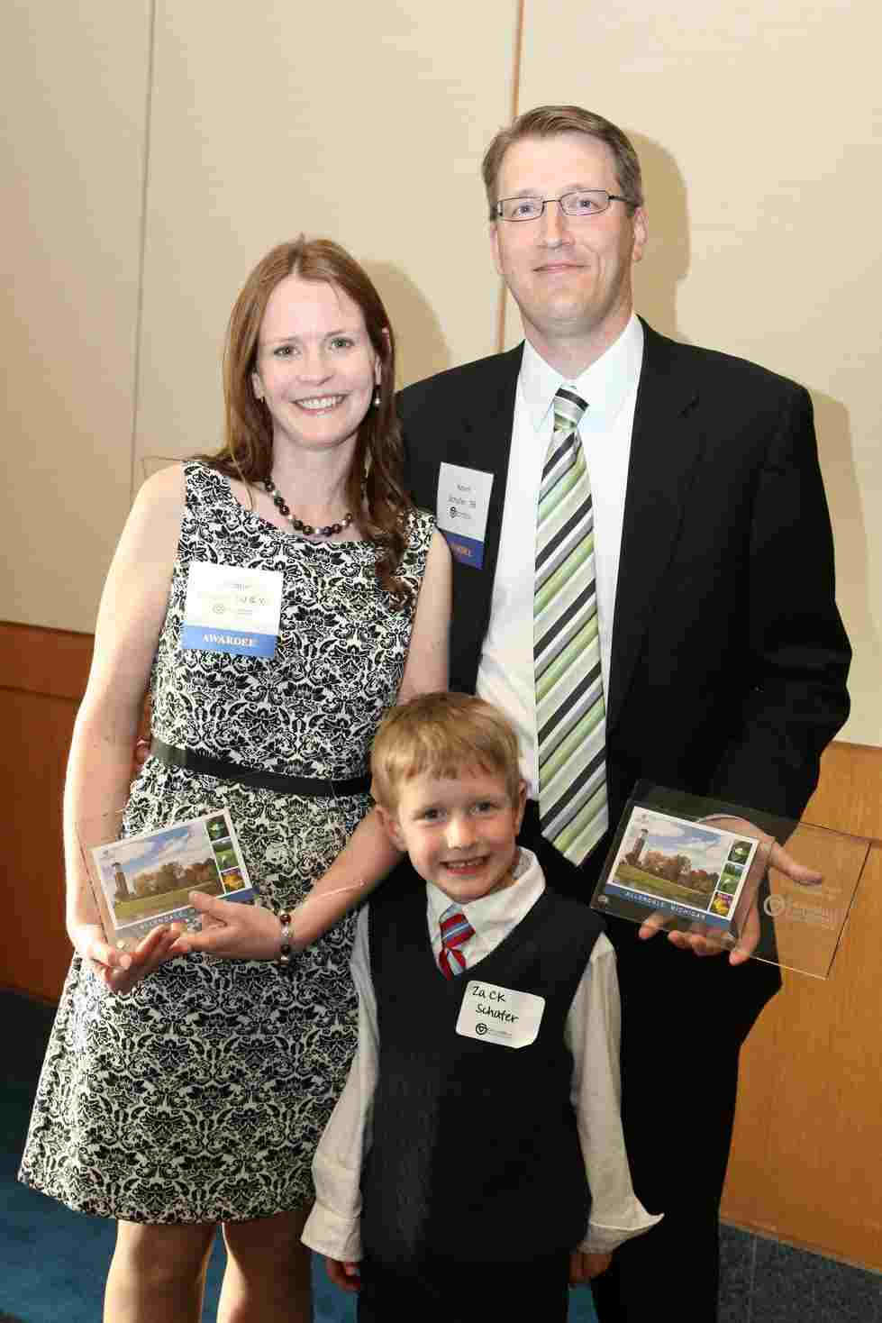 Alumni Service Award recipients Kevin, 98, and Jacqueline, 00 & 05, Schafer are pictured with their son, Zack.