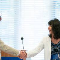President Philomena V. Mantella shakes hands with Brooks College Interim Dean Mark Schaub