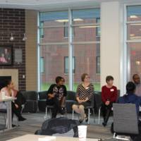 Students and faculty discussing important tasks like the students' futures at GVSU and beyond