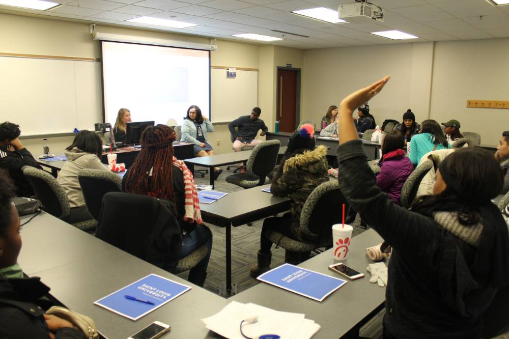 Students learning about grad school at Saint Louis University