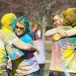 HOLI 2016 four students hugging