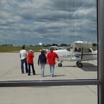 Red campers getting ready to board a plane