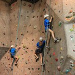Blue campers working the climbing wall