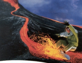 Man surfing down a volcano