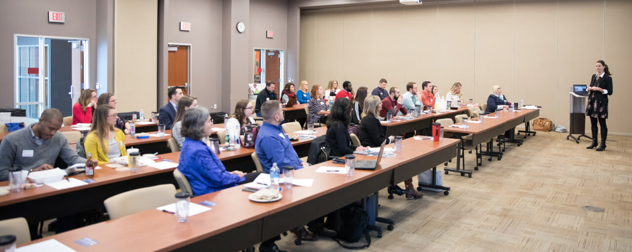 Ann Vidro presents to a group of young professionals in higher education at Davenport University