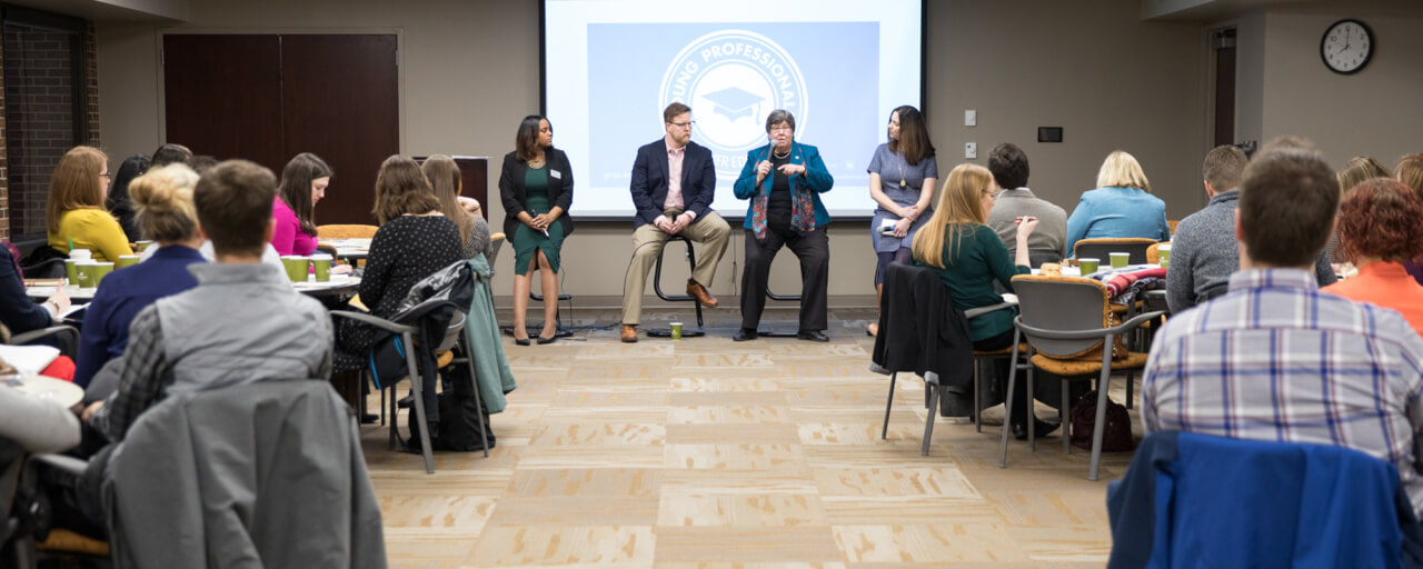 Three professionals present at the leadership panel breakfast hosted by Western Michigan University