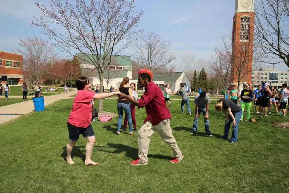 Students dancing on the Kirkhof lawn
