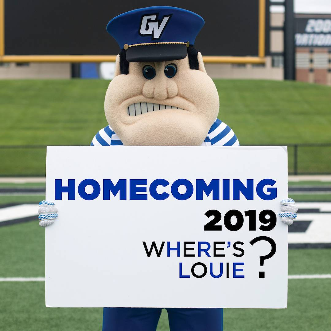 "A photo of Louie the Laker holding a sign that reads ""Homecoming 2019"""
