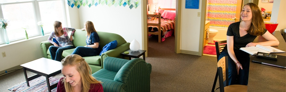 Four female students sitting in residence hall room
