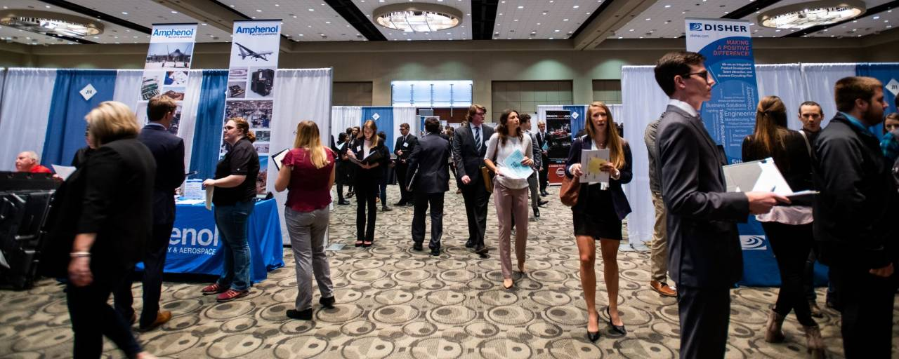 Picture of Fall Career Fair with students walking around the ball room
