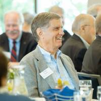 Guest smiling at a speaker at the Foundation Annual Meeting