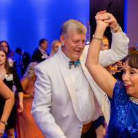 President Tom Haas dancing with guest at Enrichment